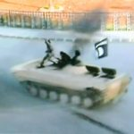 ISIL hoons do wheelies in captured vehicle.