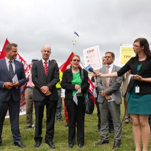 MPs from Greens and Labor, academics, Medecins Sans Frontieres and the general public gather outside Parliament House Canberra on 20 Oct 2014 to protest the proposal that Australia signs the TPP agreement.