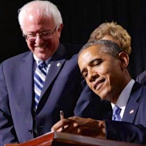 Right: Sanders witnesses the signing of a Bill into law by President Obama