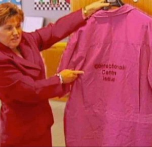 Photo: Queensland Police Minister Jo-Ann Miller displays some of the pink prison uniforms which were once a brain explosion of an idea, now abandoned, by a former state government.   – Josh Bavas, ABCTV