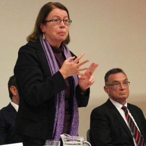 Photo: Dr Pat Ranald speaking at the Grifith forum. Former MP Chris Emerson is seated. – Pic: Bill Rowlings